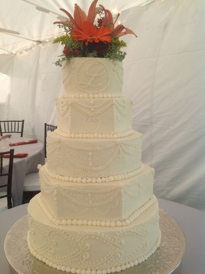 Six tier wedding cake with flowers on top