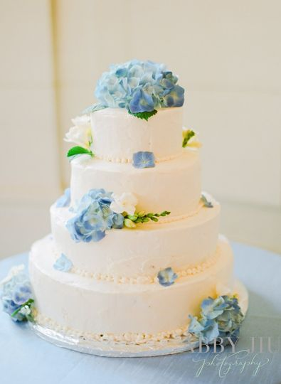 Blue flowers on white cake