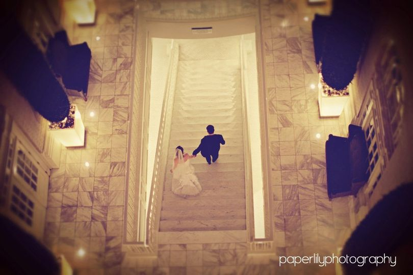 Newlyweds going down the stairs