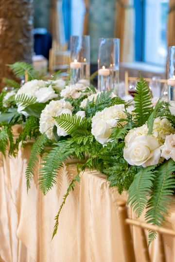 White table arrangement with foliage