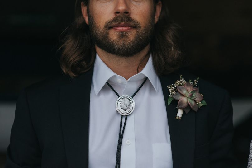 Groom's bolo tie and boutonniere