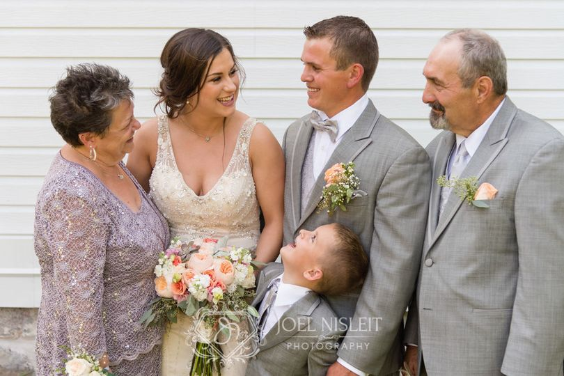 First Lutheran Church Middleton wedding photographer bride and groom family portrait outdoors.