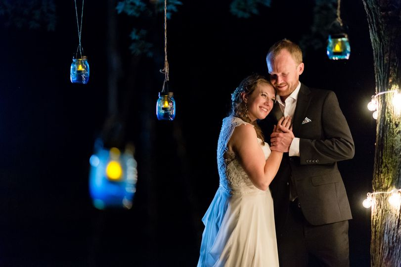 Riveredge Nature Center West Bend wedding photographer couple portrait under tree with lights at...