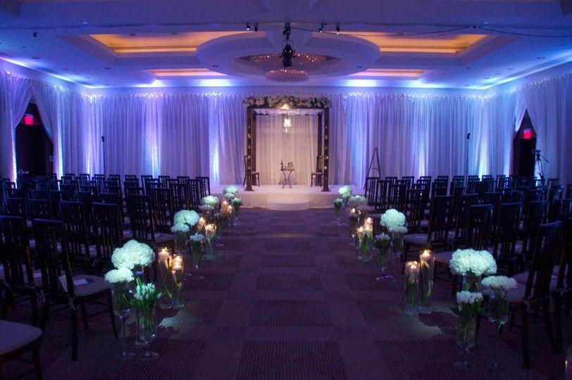 Elegant uplighting and aisle pinspots