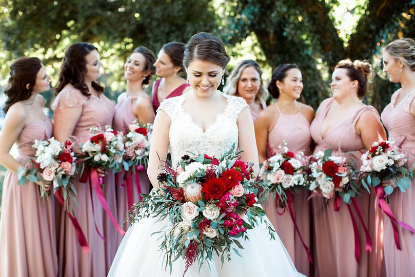 The bride with her bridesmaids holding a bouquet