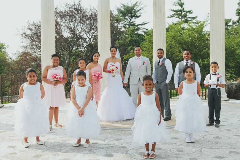 The couple with the bridesmaids, groomsmen and flower girls