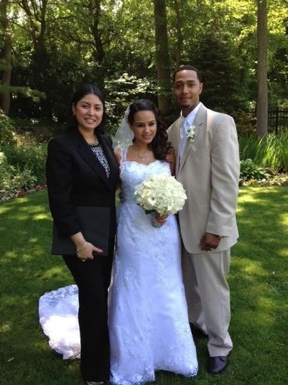 Post-ceremony photo of the newlyweds and officiant