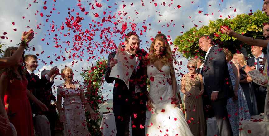 Showering the newlyweds with rose petals is both romantic and ecological!
