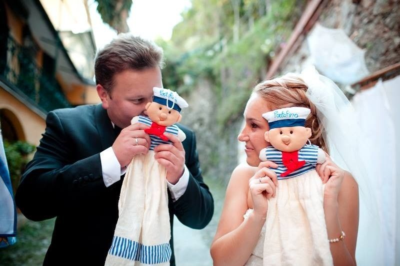 Newlyweds getting playful with their Italian dolls.