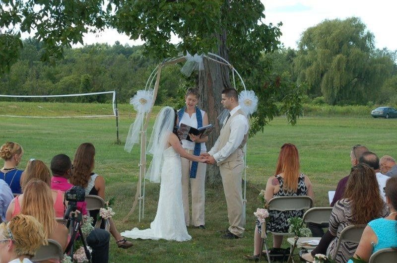 Outdoor weddings, like this one at Duke's Grove, are a specialty of Chaplain Claudia.  Photo...