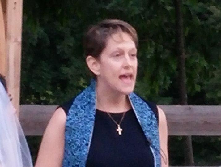Chaplain Claudia performs a wedding ceremony at Liberty Ridge Farm in Schagticoke, NY.