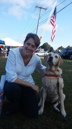 Chaplain Claudia and one of her canine friends.