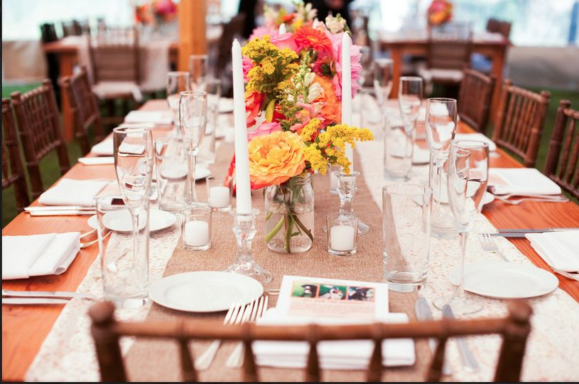 Table setting with candle and flower centerpiece