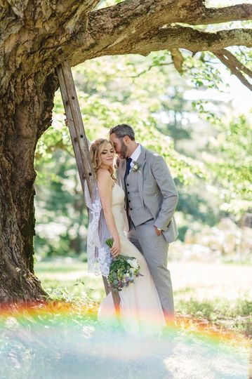 Newlyweds by the tree
