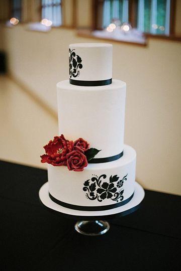 black and white cake with crimson sugar bloom