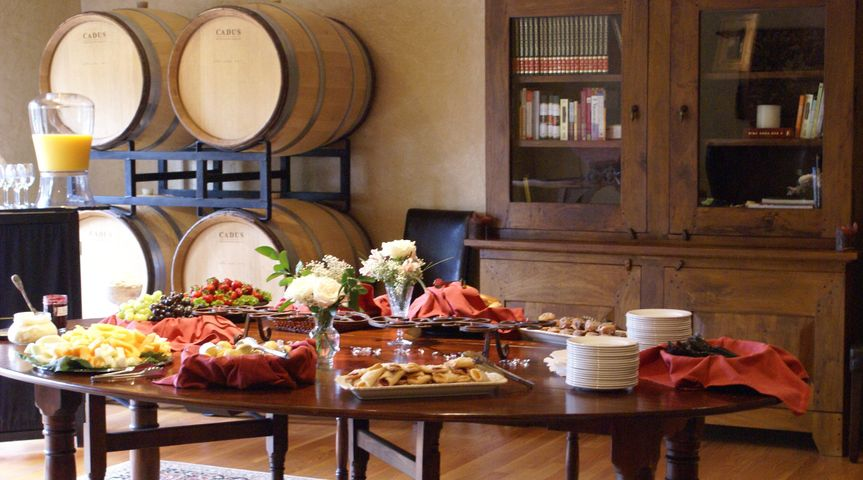Brunch in the Barrel Room tempting your Guests with juice, muffins, bagels, Danish and fresh fruit