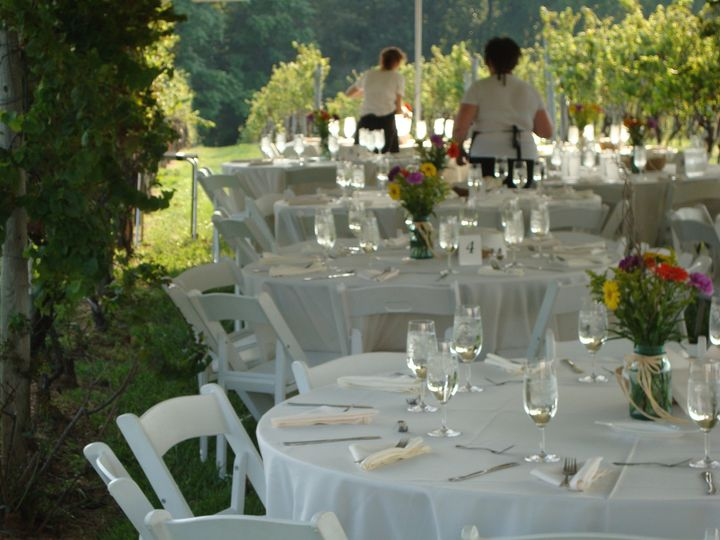 Sara and Leah set the tables in the Vineyard