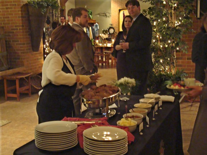 Stephanie serves Swet Poataoes to the waiting Guests who will help themselves to Cinnamon Cream,...
