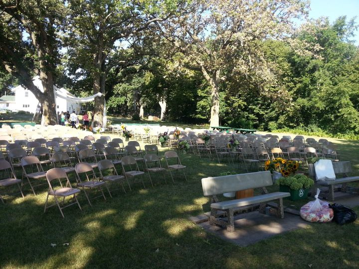 Outdoor Lakefront lawn wedding chair setup