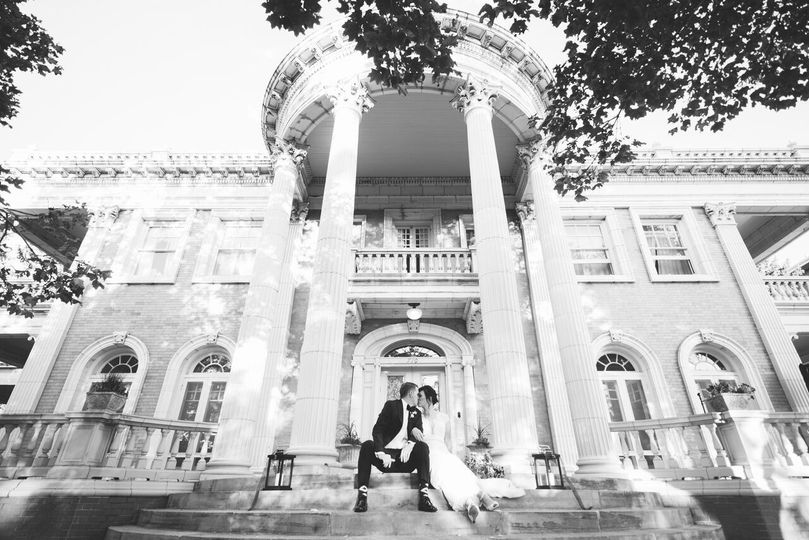 Newlyweds in front of the venue