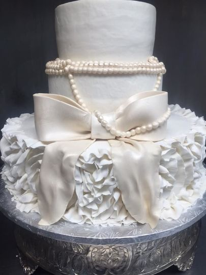 Ruffle design with pearls and gum paste bow