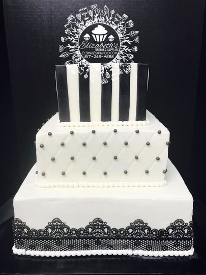 Buttercream with edible lacework and fondant stripes along with diamond lattice work