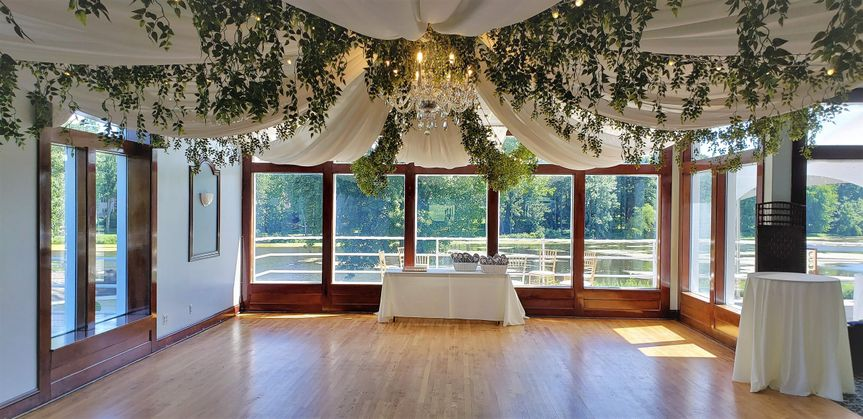 Ceiling draping with greenery