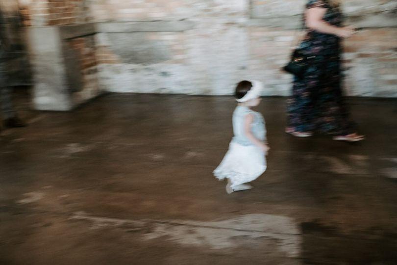 Little girl running at wedding
