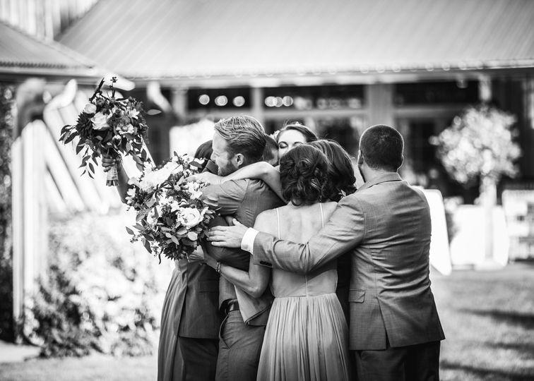 Wedding party group hug