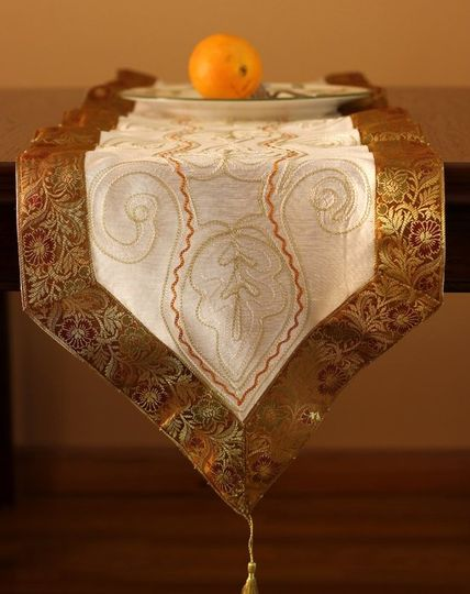 Gold and white ornamental table runner