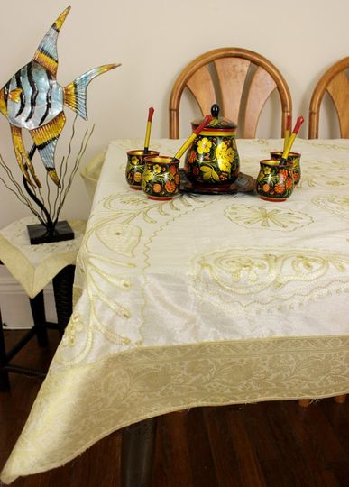 Beautiful ornamental square tablecloth display featuring beige embroidered patterns