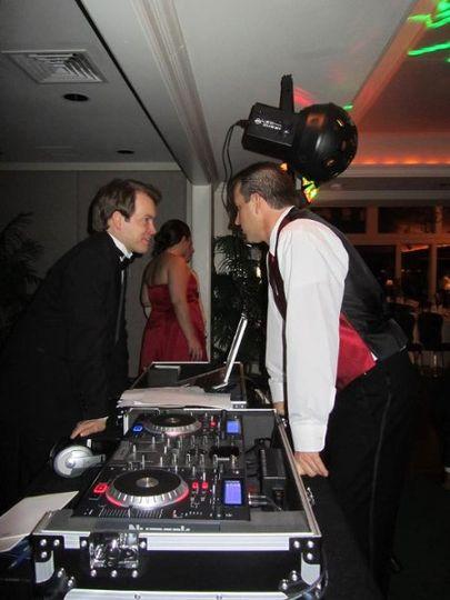 Groom and DJ talking