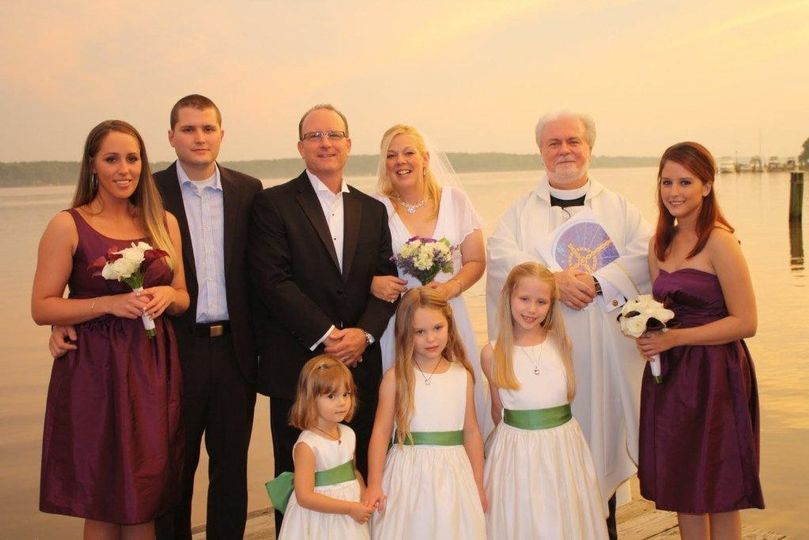 Wedding attendants with the officiant