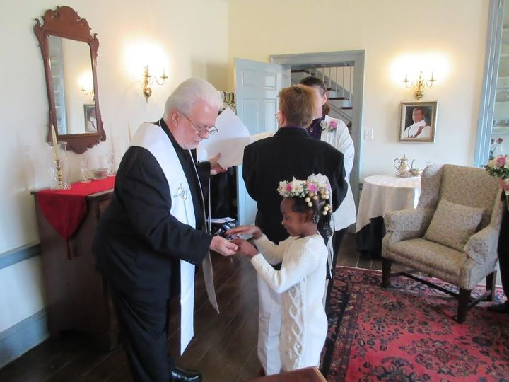 The flower girl with the wedding officiant
