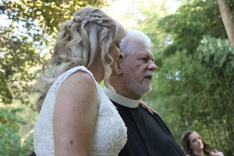The bride and the wedding officiant