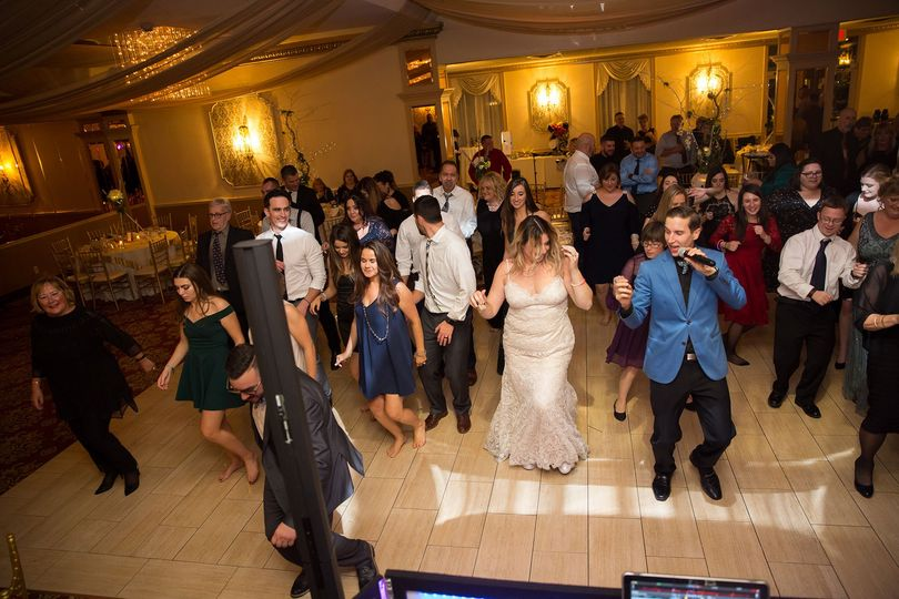 Dancing newlyweds with guests