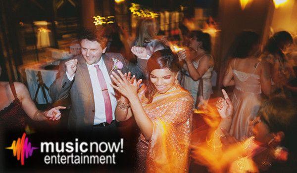 dj john celebrating an indian weddin