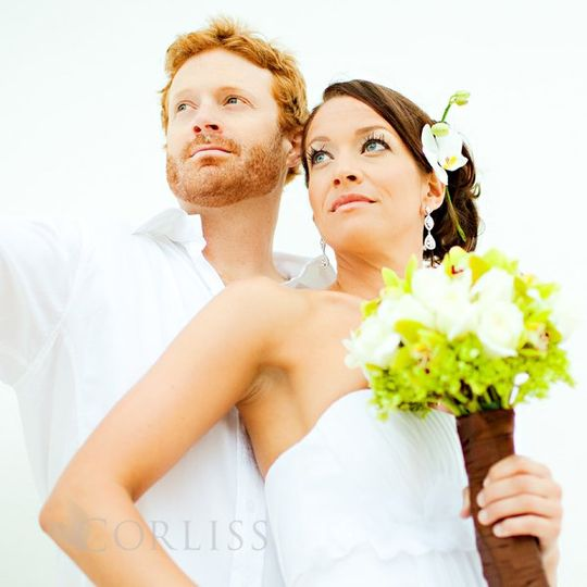 Bride and groom shoot before beach ceremony.