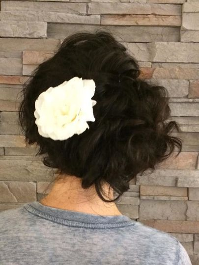Wedding updo with white rose