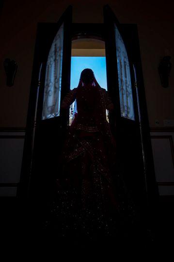Bride beside a window