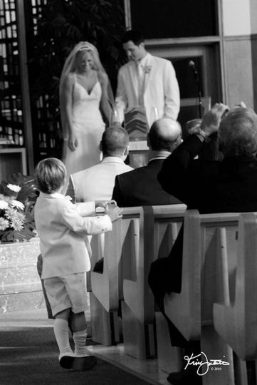 Little ring bearer watching ceremony.
