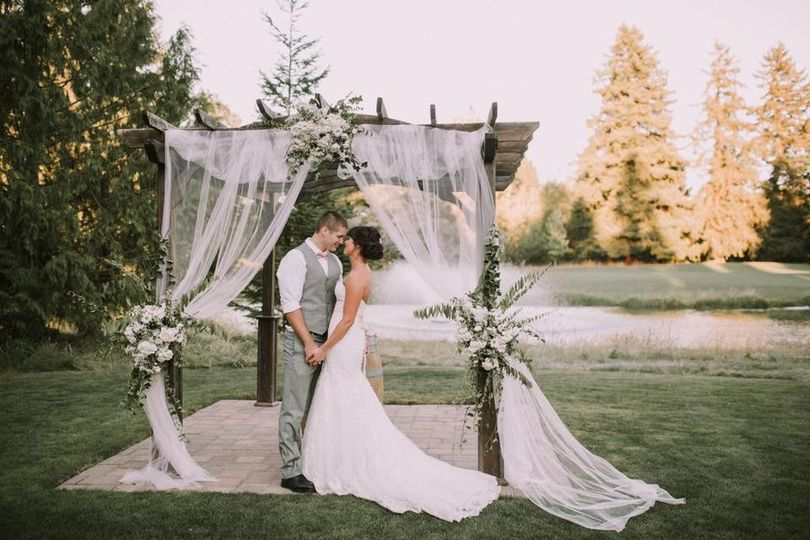 Couple in a wedding arbor