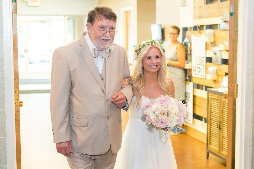 The bride escorted
