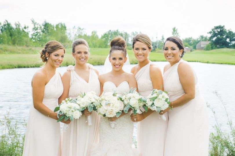 Bride and company by the lake