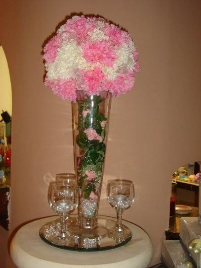 Centerpiece for the Cinderella wedding. Tall and studding this centerpiece is a true attention...