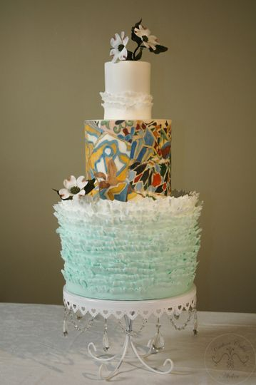This cake was inspired by the tiles of a bench in Gaudi's Park Güell in Barcelona. This image was...
