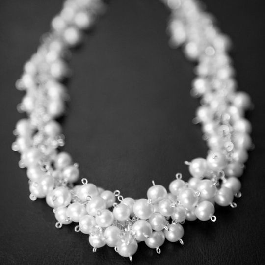 This stunning necklace was handmade with over one hundred freshwater pearls clustered with genuine...