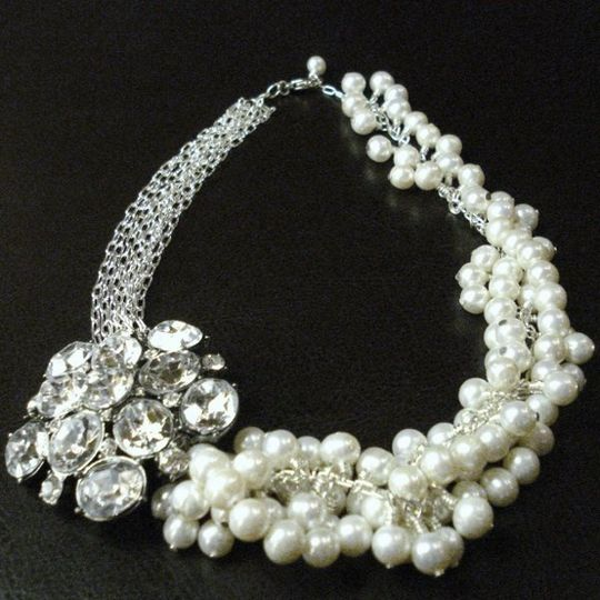 A statement piece, this stunning bridal necklace is made with over one hundred freshwater pearls...
