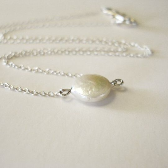 A gorgeous little freshwater coin pearl seemingly floats on the delicate sterling silver chain. This...
