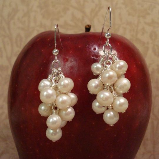 Beautifully shaped freshwater pearls clustered together to make these earrings. They are the epitome...